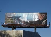 A billboard featuring Harrison Ford
